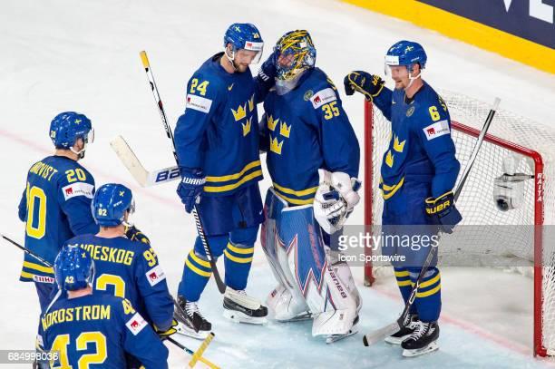 Goalie Henrik Lundqvist celebrates the win with Alexander Edler and Anton Stralman during the Ice Hockey World Championship Quarterfinal between...