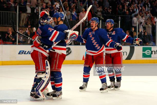 Goalie Henrik Lundqvist, Dan Girardi, Ryan McDonagh and Brad Richards of the New York Rangers celebrate after they won 2-1 against the Washington...