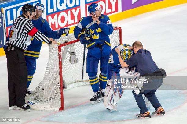 Goalie Henrik Lundqvist gets a medical treatment after clashing with Denis Hollenstein during the Ice Hockey World Championship Quarterfinal between...