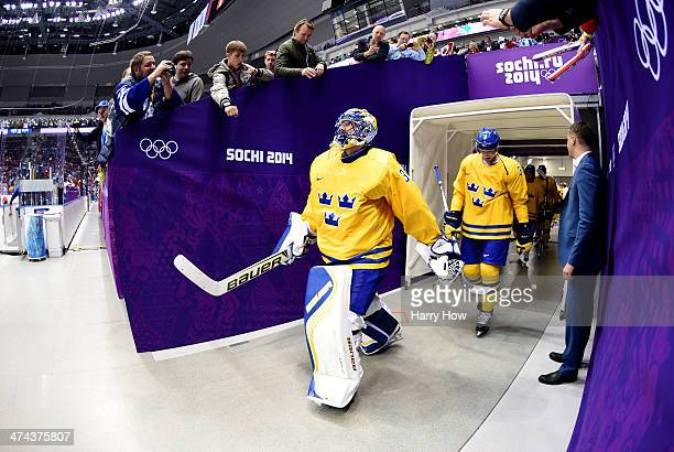 Goalie Henrik Lundqvist of Sweden leads out his team during the Men's Ice Hockey Gold Medal match on Day 16 of the 2014 Sochi Winter Olympics at...