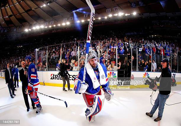 Goalie Henrik Lundqvist of the New York Rangers celebrates after he was named a star of the game after the Rangers won 2-1 against the Washington...