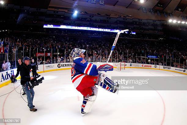 Goalie Henrik Lundqvist of the New York Rangers celebrates after he was named a star of the game after the Rangers won 21 against the Washington...