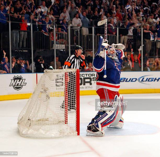 Goalie Henrik Lundqvist of the New York Rangers celebrates after they won 2-1 against the Washington Capitals in Game Seven of the Eastern Conference...