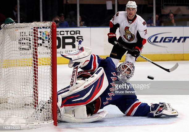 Goalie Henrik Lundqvist of the New York Rangers gives up a third period goal to Erik Condra of the Ottawa Senators in Game One of the Eastern...