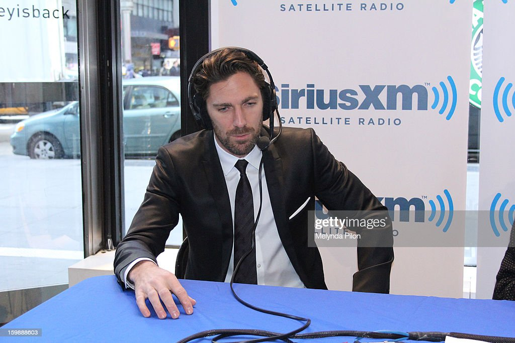 Goalie Henrik Lundqvist of the New York Rangers is interviewed by Chris Russo on Sirius XM Radio at the NHL Powered by Reebok Store on January 22, 2013 in New York City.