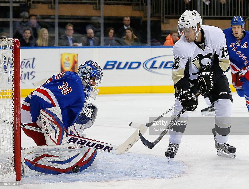 Goalie Henrik Lundqvist #30 of the New York Rangers makes a save against Brandon Sutter #16 of the Pittsburgh Penguins in the first perod of an NHL hockey game at Madison Square Garden on January 31, 2013 in New York City.