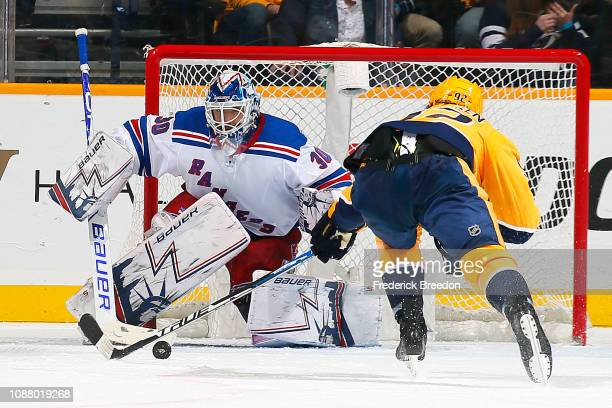 Goalie Henrik Lundqvist of the New York Rangers watches Ryan Johansen of the Nashville Predators try to corral the puck during the second period at...