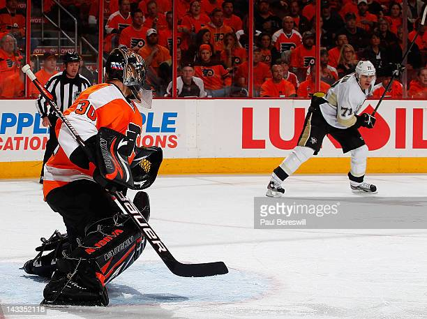 Goalie Ilya Bryzgalov of the Philadelphia Flyers defends as Evgeni Malkin of the Pittsburgh Penguins waits to shoot the puck in Game Six of the...