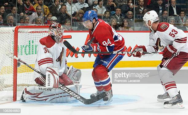 Goalie Ilya Bryzgalov of the Phoenix Coyotes stops the puck while Tom Pyatt of the Montreal Canadiens steps into his zone trailed Derek Morris of the...