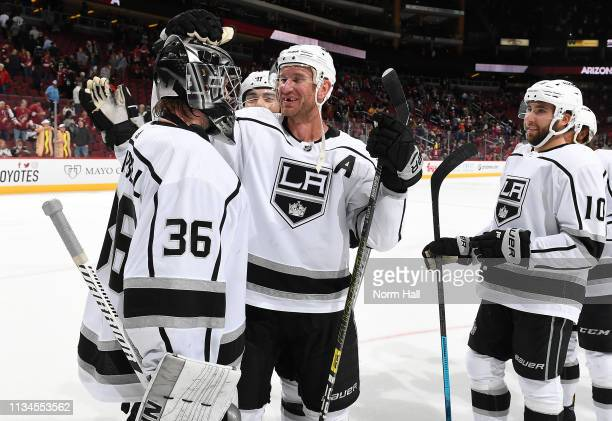Goalie Jack Campbell of the Los Angeles Kings is congratulated by Jeff Carter Michael Amadio and teammates after a 31 victory against the Arizona...