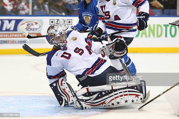 Goalie Jack Campbell of USA covers up after making a save during the 2011 IIHF World U20 Championship game between USA and Finland on December 26,...