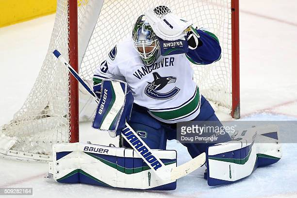 Goalie Jacob Markstrom of the Vancouver Canucks makes a glove save against the Colorado Avalanche at Pepsi Center on February 9 2016 in Denver...