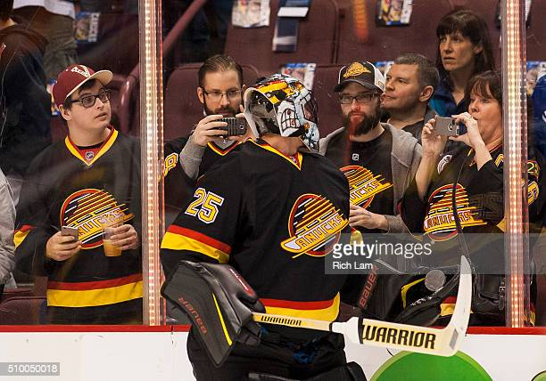 Goalie Jacob Markstrom of the Vancouver Canucks turns to fans for a picture prior to NHL action against the Toronto Maple Leafs on February 2016 at...