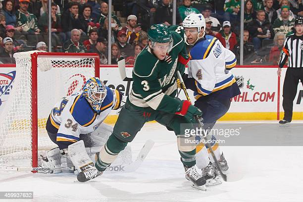 Goalie Jake Allen and Carl Gunnarsson of the St Louis Blues defend their goal against Charlie Coyle of the Minnesota Wild during the game on November...