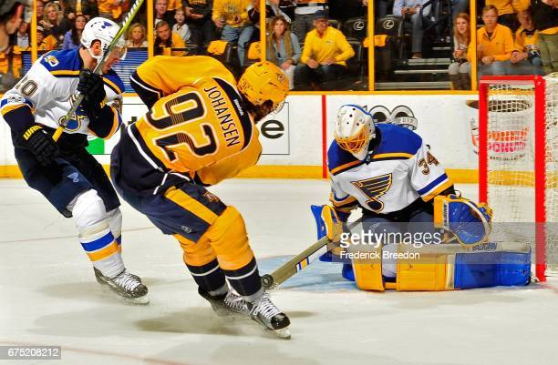 Goalie Jake Allen of the St Louis Blues blocks a pass by Ryan Johansen of the Nashville Predators during the first period in Game Three of the...
