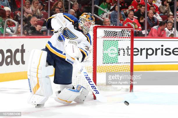 Goalie Jake Allen of the St Louis Blues hits the puck in the second period against the Chicago Blackhawks at the United Center on November 14 2018 in...