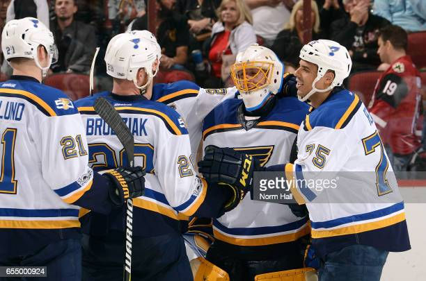 Goalie Jake Allen of the St Louis Blues is congratulated by teammates Ryan Reaves Kyle Brodziak and Patrik Berglund after a 30 shutout victory...