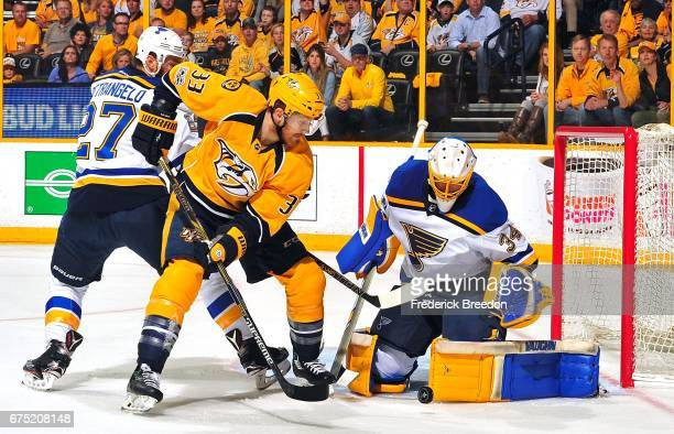 Goalie Jake Allen of the St. Louis Blues makes a save against Colin Wilson of the Nashville Predators during the first period in Game Three of the...