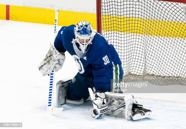 Goalie Jake Kielly of the Vancouver Canucks makes a save on the first day of the Vancouver Canucks NHL Training Camp on January 2021 at Rogers Arena...