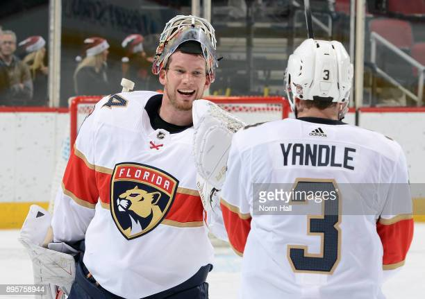 Goalie James Reimer of the Florida Panthers is congratulated by teammate Keith Yandle after a 32 victory against the Arizona Coyotes at Gila River...