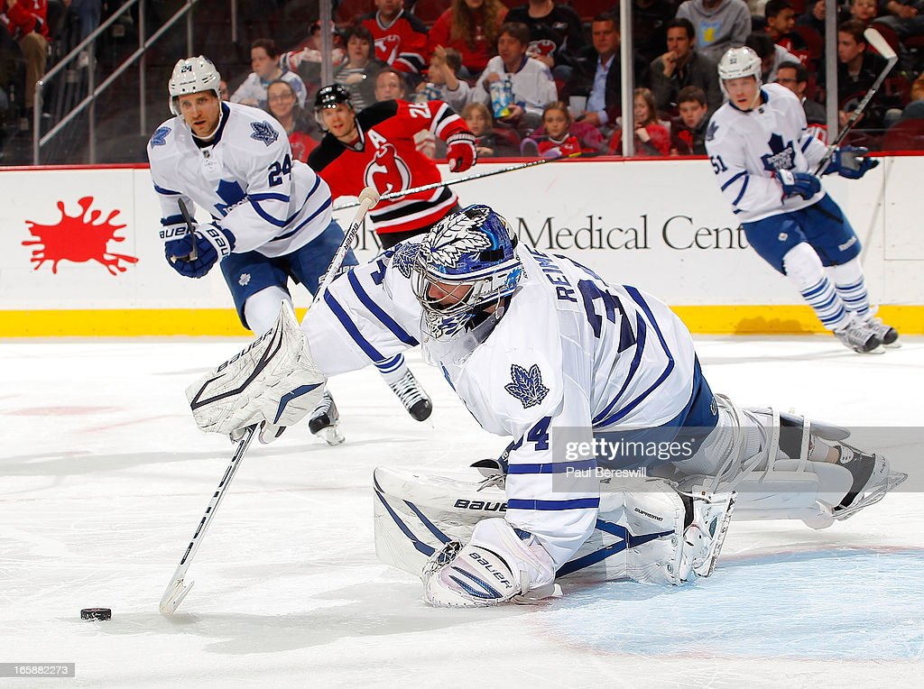 Goalie James Reimer #34 of the Toronto Maple Leafs dives out of the net to stop the puck during the second period of an NHL hockey game against the New Jersey Devils at Prudential Center on April 6, 2013 in Newark, New Jersey. The Leafs won 2-1.