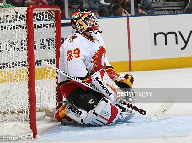 Goalie Jamie McLennan of the Calgary Flames looks up at the scoreboard after a goal by Joffrey Lupul of the Edmonton Oilers during their NHL...