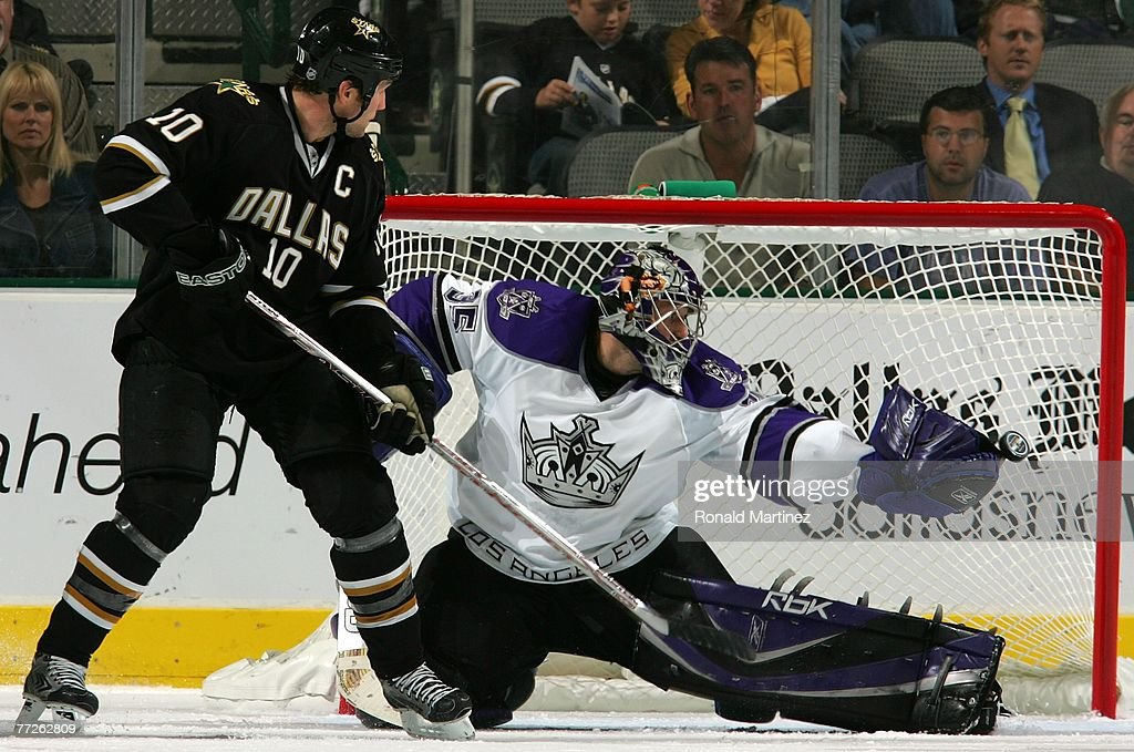 Goalie Jason LaBarbera #35 of the Los Angeles Kings makes a glove save in front of Brenden Morrow #10 of the Dallas Stars at the American Airlines Center on October 10, 2007 in Dallas, Texas.