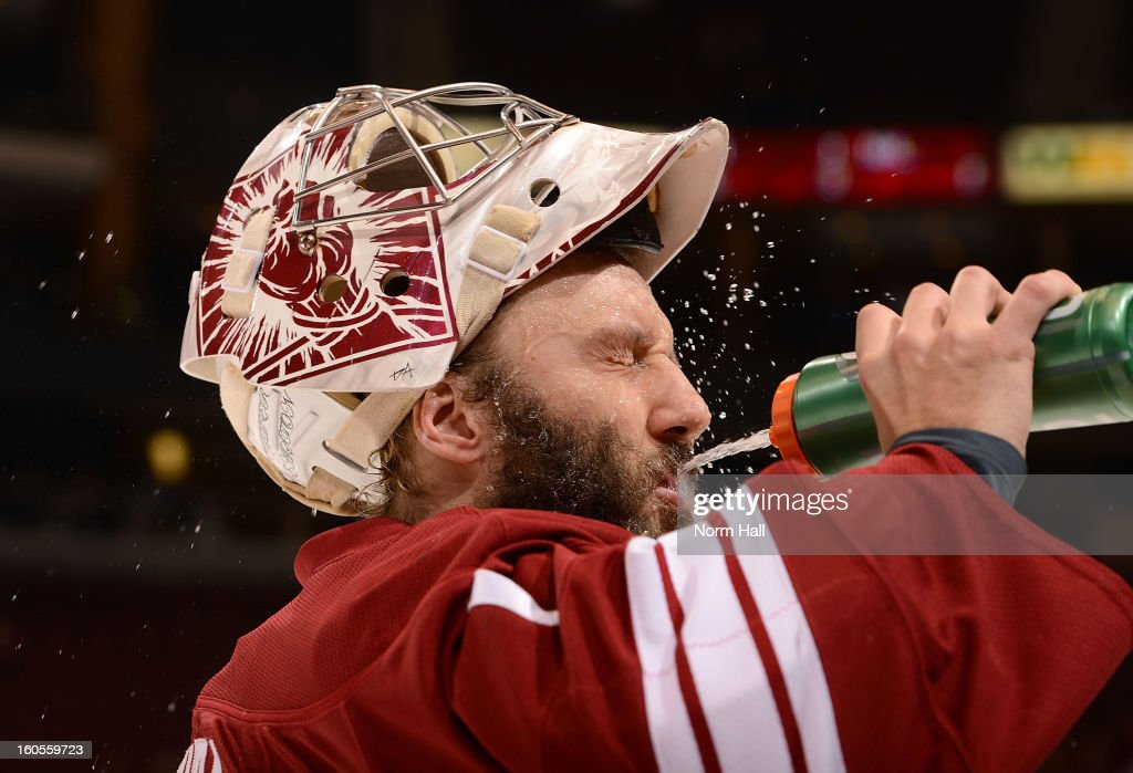 Goalie Jason LaBarbera #1 of the Phoenix Coyotes pauses for a drink during the pre-game skate before the start of their game against the Dallas Stars at Jobing.com Arena on February 2, 2013 in Glendale, Arizona.