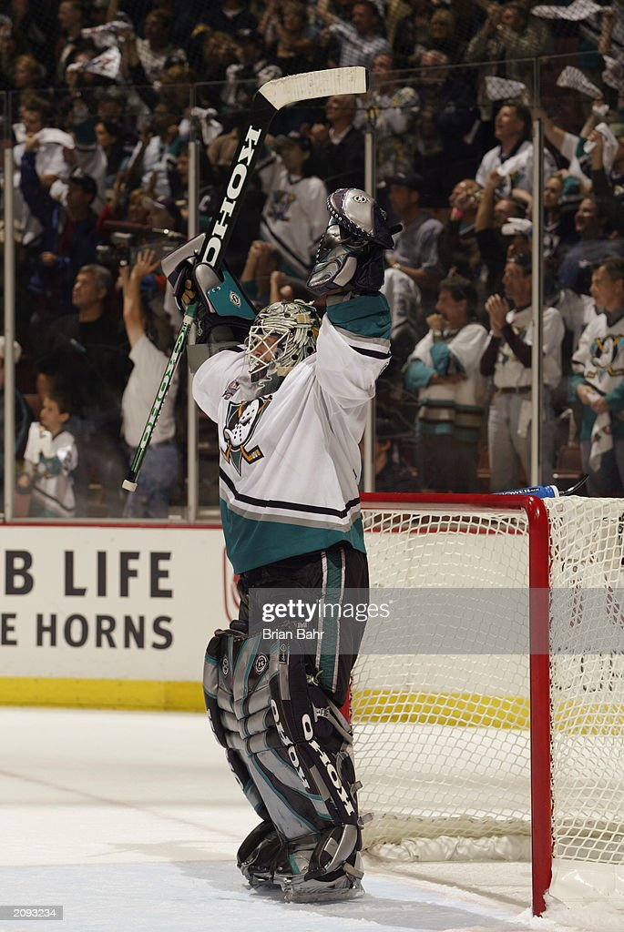 Goalie Jean-Sebastien Giguere of the Anaheim Mighty Ducks celebrates after defeating the New Jersey Devils in Game Six of the 2003 Stanley Cup Finals at the Arrowhead Pond of Anaheim on June 7, 2003 in Anaheim, California. The Ducks won 5-2.