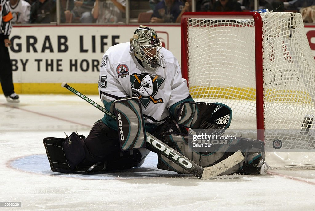 Goalie Jean-Sebastien Giguere #35 of the Anaheim Mighty Ducks makes a save against the New Jersey Devils during the third period in Game Six of the 2003 Stanley Cup Finals at the Arrowhead Pond of Anaheim on June 7, 2003 in Anaheim, California. The Ducks won 5-2.