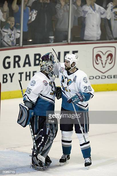 Goalie JeanSebastien Giguere of the Mighty Ducks of Anaheim is congratulated by teammate Steve Rucchin after defeating the New Jersey Devils 52 in...