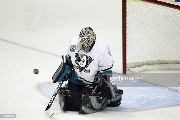 Goalie JeanSebastien Giguere of the Mighty Ducks of Anaheim makes a save on a shot by the New Jersey Devils in game six of the 2003 Stanley Cup...