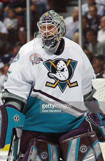 Goalie JeanSebastien Giguere of the Mighty Ducks of Anaheim waits for play to resume against the New Jersey Devils in game three of the 2003 Stanley...