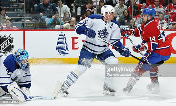 Goalie JeanSebastien Giguere of the Toronto Maple Leafs stops the game in front of Tomas Plekanec of the Montreal Canadiens during the NHL game on...