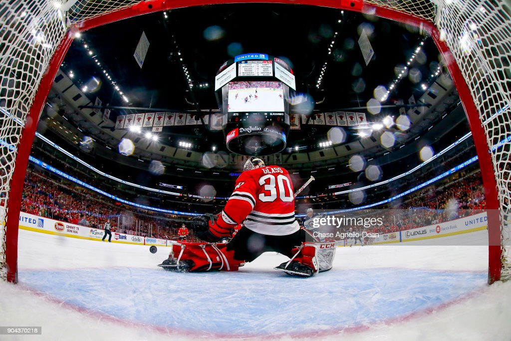 Goalie Jeff Glass #30 of the Chicago Blackhawks guards the net during the game against the Winnipeg Jets at the United Center on January 12, 2018 in Chicago, Illinois.