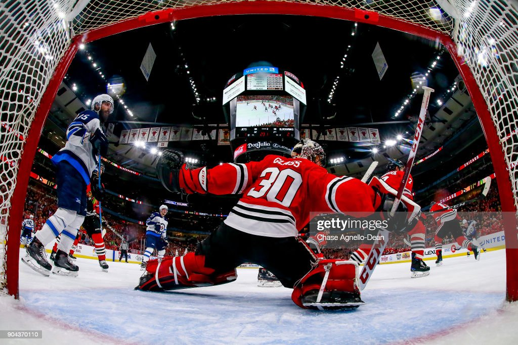 Goalie Jeff Glass #30 of the Chicago Blackhawks guards the net in the third period against the Winnipeg Jets at the United Center on January 12, 2018 in Chicago, Illinois.
