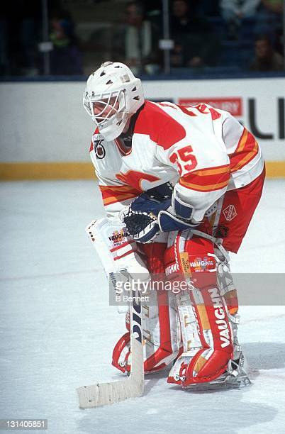 Goalie Jeff Reese of the Calgary Flames defends the net during an NHL game in February 1992 at the Olympic Saddledome in Calgary Alberta Canada