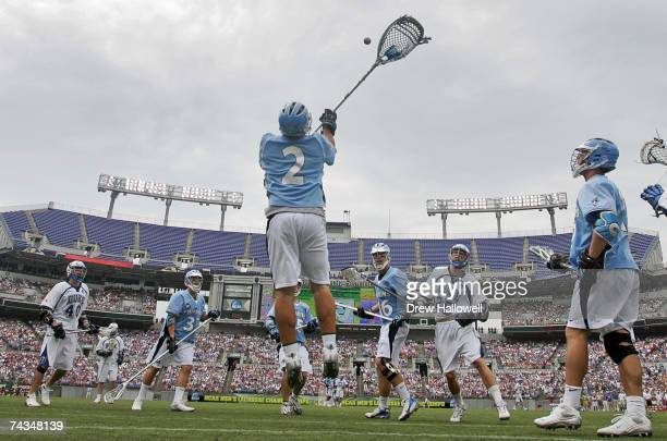Goalie Jesse Schwartzman of Johns Hopkins jumps into the air to knock away the ball on the way to winning the NCAA Division I lacrosse championship...