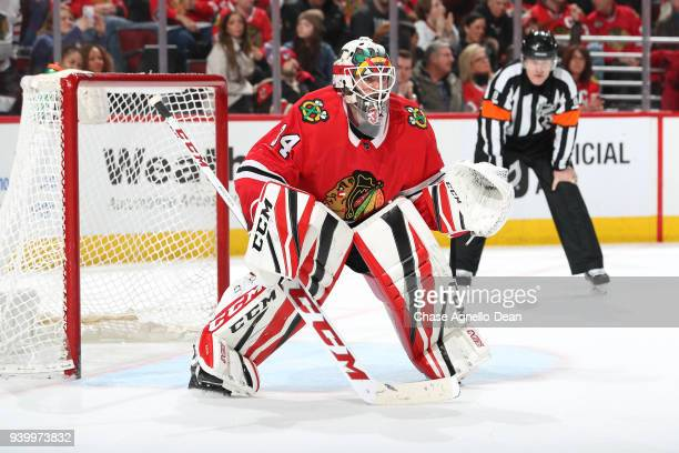 Goalie JF Berube of the Chicago Blackhawks guards the net in the third period against the Colorado Avalanche at the United Center on March 6 2018 in...