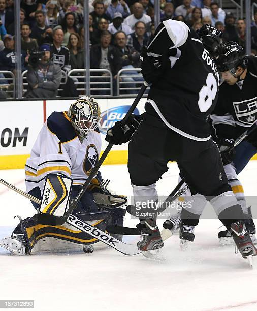 Goalie Jhnoas Enroth of the Buffalo Sabres stops a shot by Drew Doughty of the Los Angeles Kings at Staples Center on November 7 2013 in Los Angeles...