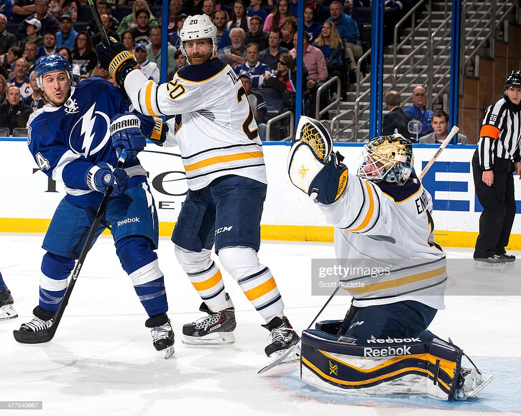 Goalie Jhonas Enroth #1 of the Buffalo Sabres makes a save as teammate Henrik Tallinder #20 and Ryan Callahan #24 of the Tampa Bay Lightning look on during the third period at the Tampa Bay Times Forum on March 6, 2014 in Tampa, Florida.