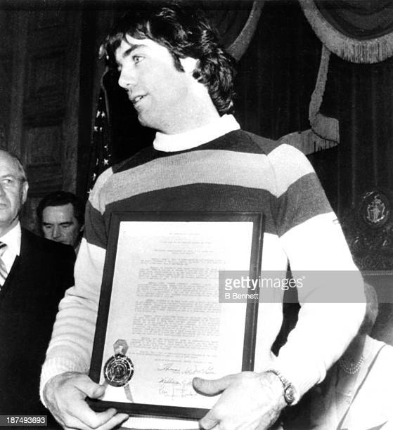 Goalie Jim Craig of Team USA holds up a citation presented to him by Republican Leon J. Lombardi during ceremonies at the State House on February 27,...