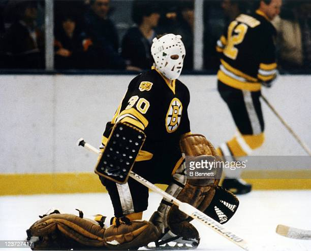 Goalie Jim Craig of the Boston Bruins warms up before an NHL game in October 1980