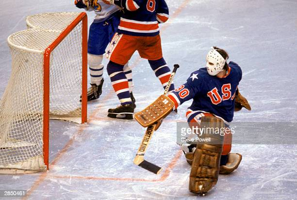 Goalie Jim Craig of the United States makes a save during the Olympic hockey game against Finland on February 24 1980 in Lake Placid New York The...