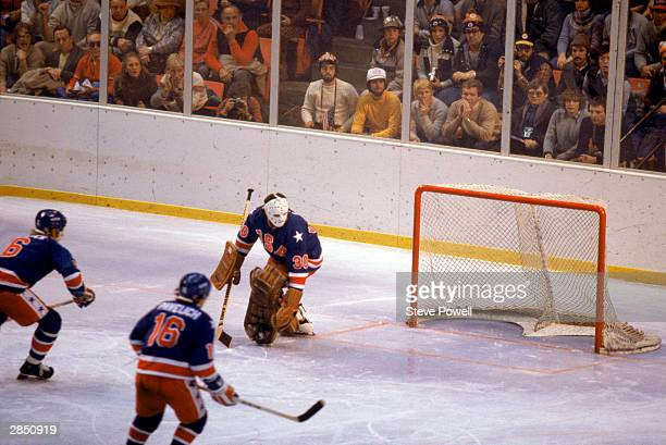 Goalie Jim Craig of the United States watches the puck sail by during the Olympic hockey game against Finland on February 24 1980 in Lake Placid New...