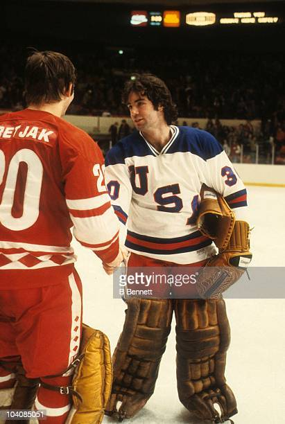Goalie Jim Craig shakes hands with fellow goalie Vladislav Tretiak of the USSR after the Soviet team beat Team USA in an exhibition game on February...
