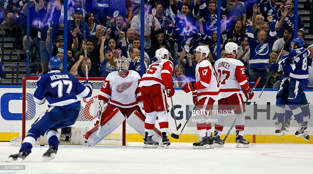 Goalie Jimmy Howard #35 of the Detroit Red Wings reacts as members of the Tampa Bay Lightning celebrate a goal during the third period in Game One of the Eastern Conference Quarterfinals during the 2016 NHL Stanley Cup Playoffs at Amalie Arena on April 13, 2016 in Tampa, Florida.