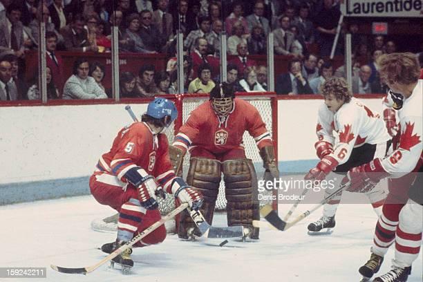 Goalie Jiri Holecek and Milan Chalupa of team Czechoslovakia block the goal against Bobby Clarke and Bobby Hull of team Canada during the Canada Cup...
