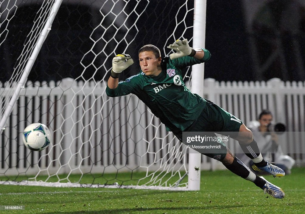 Goalie Joe Bendik #12 of Toronto FC dives for a save against Orlando City February 13, 2013 in the second round of the Disney Pro Soccer Classic in Orlando, Florida.
