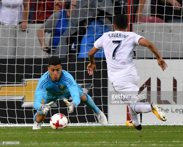 Goalie Joel Castro Pereira of Manchester United makes this first half save on a shot by Jefferson Savaring of Real Salt Lake during the International...